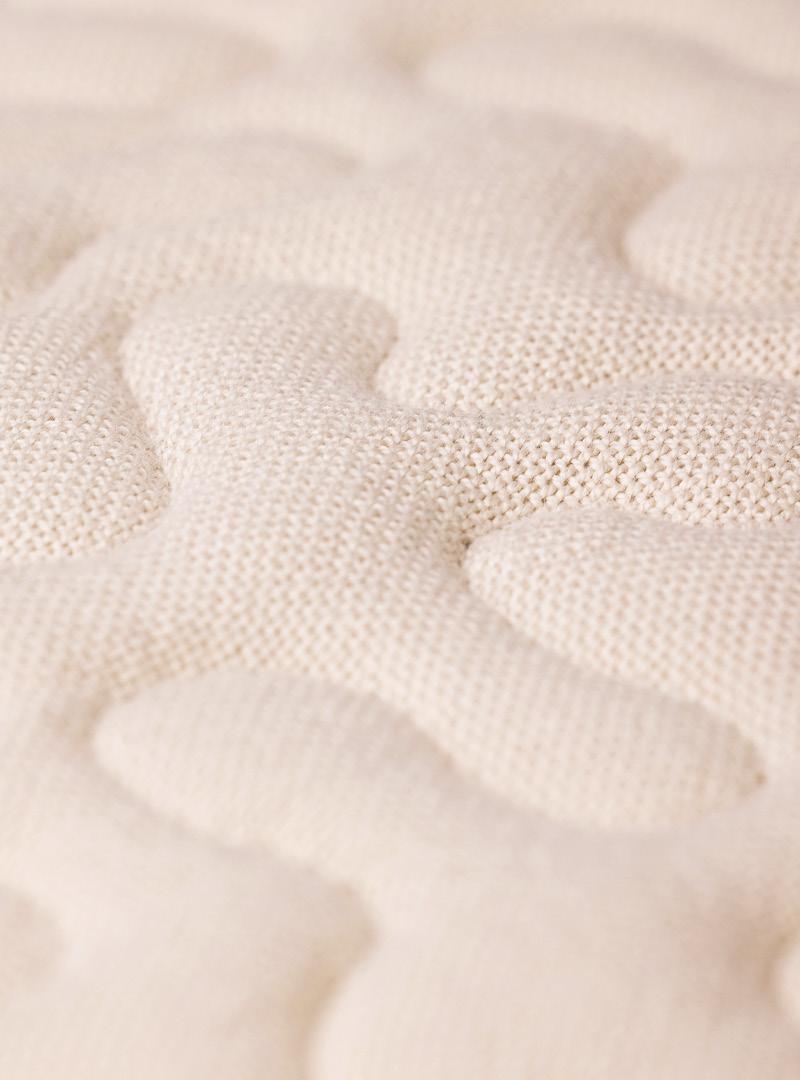 le tablier | beiger Stoff in Nahaufnahme mit einem Muster aus Rundungen
