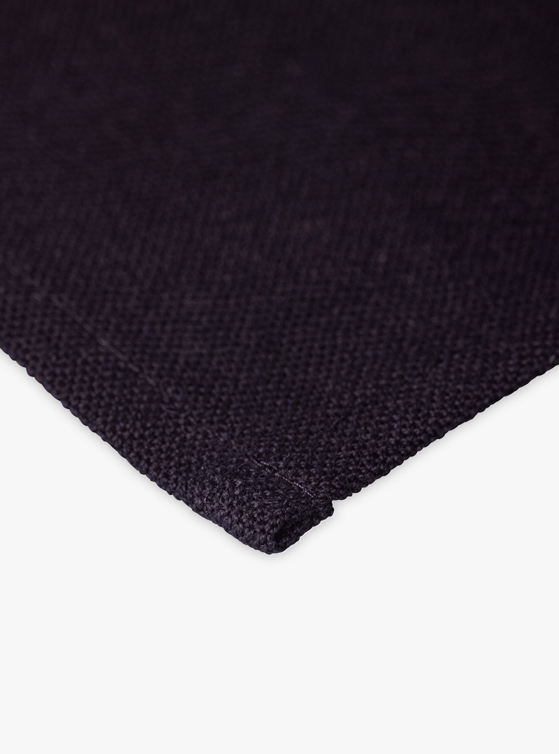 le tablier | Nahaufnahme von schwarzem Stoff eines Abtrockentuchs